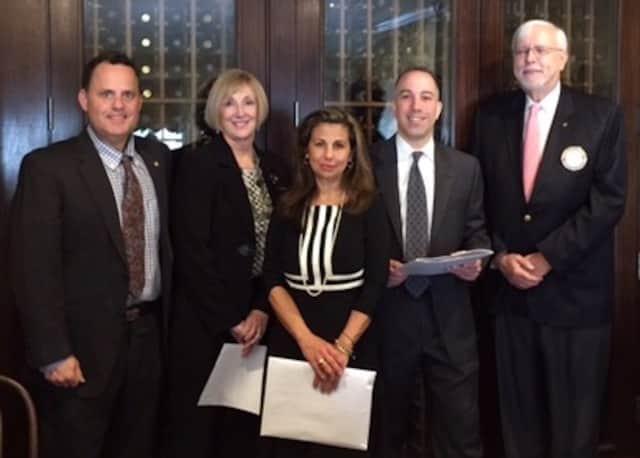 From the left, Jason L. Mehler, Pam Dwyer, Rita Tino, Raul Bello, Tom Saunders