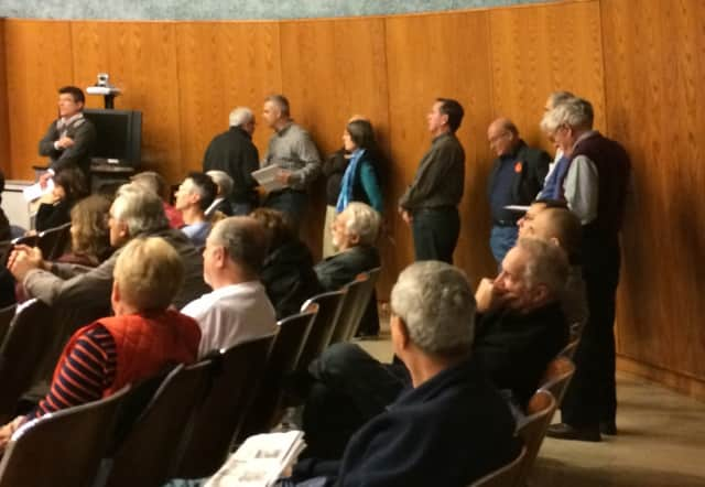 Members of the public line up Monday night to speak out against a project that would have brought more than 400 rental units to Wayne.