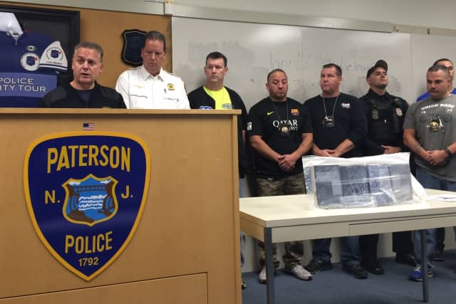 Paterson Police Director Jerry Speziale, at left, at news conference announcing $2M heroin bust.