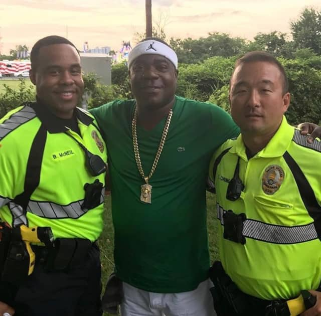 Tracy Morgan poses with Leonia Police Officers Brandon McNeil, left, and Sihoon Chung at the Leonia Sports Boosters carnival on Wednesday.