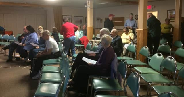 People gather for a film screening about climate change at the Ethical Culture Society of Bergen County in Teaneck.
