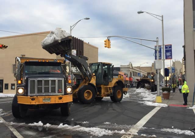Snow left behind from last week's storm is finally cleared from Main Street in Hackensack.