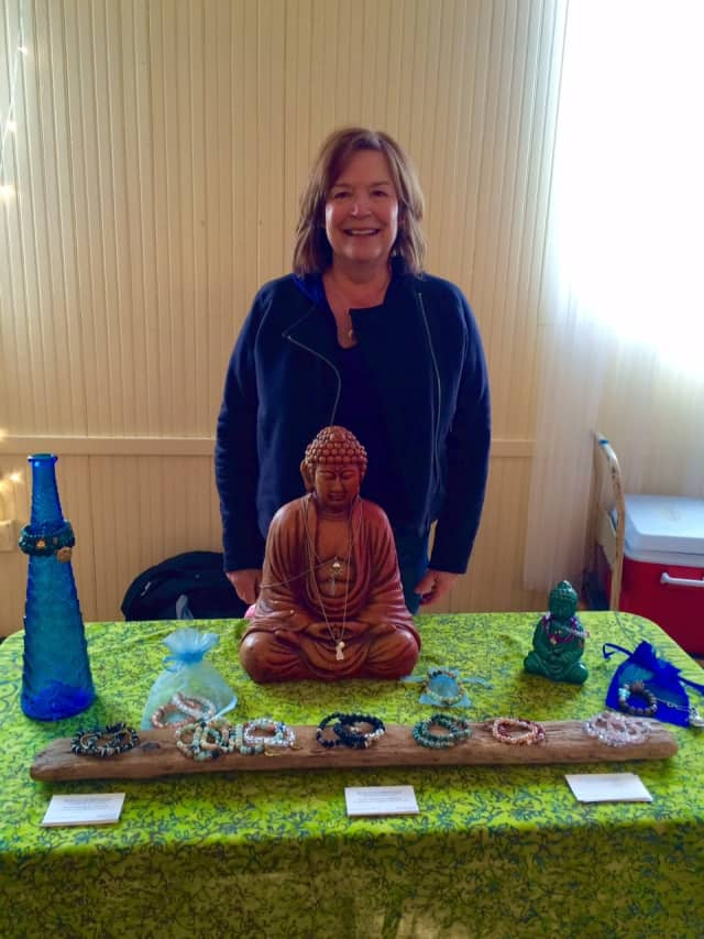 Artist Patty Robinson with some of her Blue Lotus Bracelets at the Winter Farmers Market of Southport