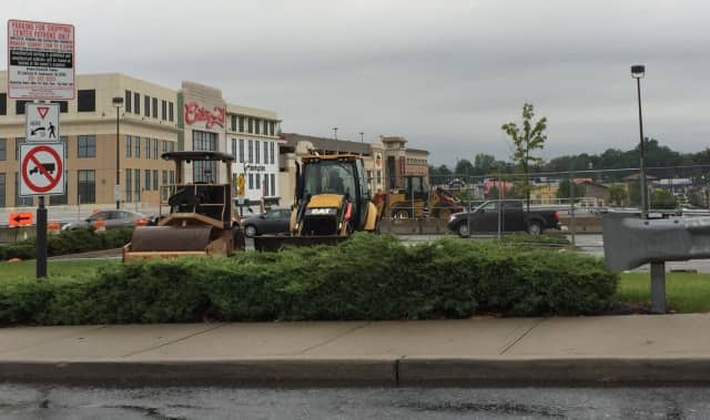 Paving is under way at the Bergen Town Center in Paramus.