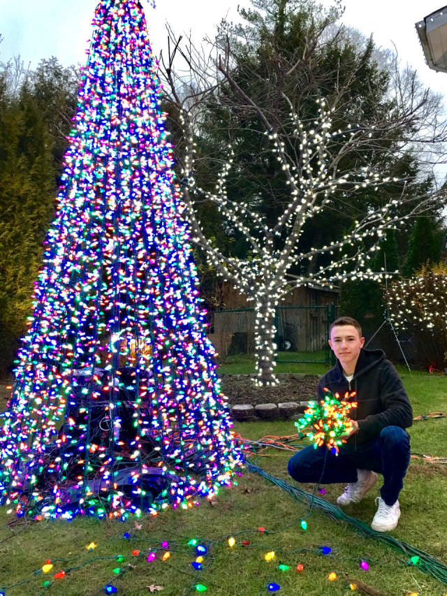 Daniel Eisenberg poses with just some of his lights in Demarest.
