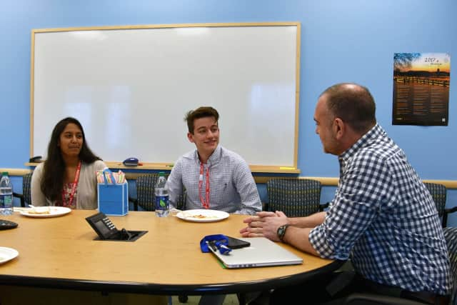 Lorenzo Muranelli from Ossining High School and Anisha Duvvi from Yorktown High School took a tour of Regeneron and met with Regeneron President and Chief Scientific Officer George Yancopoulos