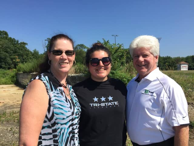 GRDP Founder Michelle Hillock, center, with Fair Lawn TD Bank official Cheryl Kastner and U.S. VP of TD Bank Marketing Thomas Hewitt at the site of the future dog park.