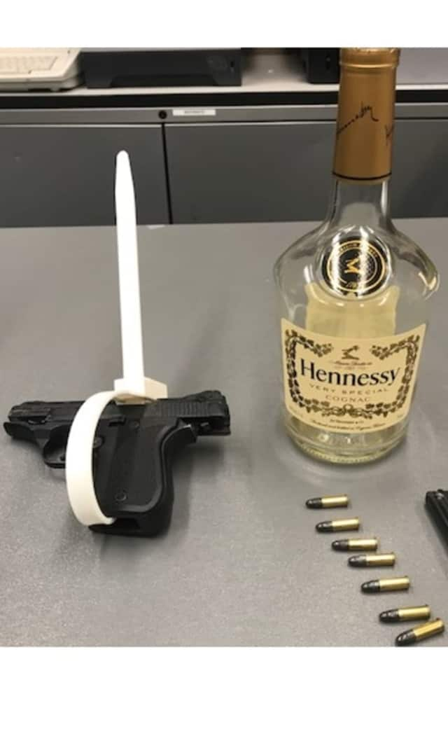 PAPD: Officers found a fully loaded Phoenix Arms .22-caliber semiautomatic handgun and a bottle of cognac.