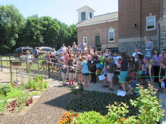 Main Street School students, teachers and administrators held a ribbon-cutting ceremony for the school garden on June 21.