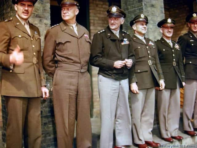 Uniforms worn by WWII soldiers are on display in the Teaneck Public Library.