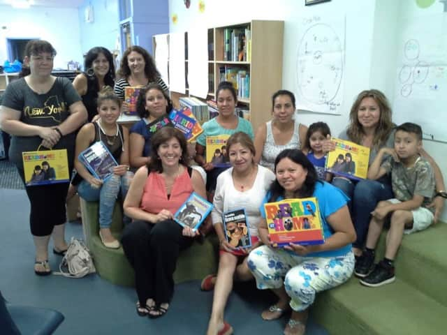 The parents learned strategies they can use at home to develop academic reading skills. Each family received a bilingual Read At Home Kit.