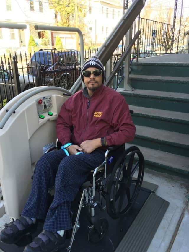 Conrado Bermudez of Paterson tries out his new chair lift, donated by Handi-Lift, Inc. in Carlstadt. The donation and connections to contractors were arranged through Giants of Generosity in Cresskill.
