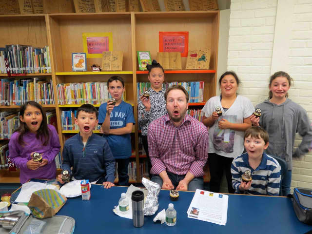 Author Adam Gidwitz visits with Todd Elementary students.