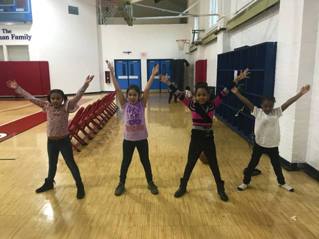 Young members of the Cardinal Shehan Center do jumping jacks as part of the Fitness for Life program supported by the Rotary Club of Bridgeport Foundation.