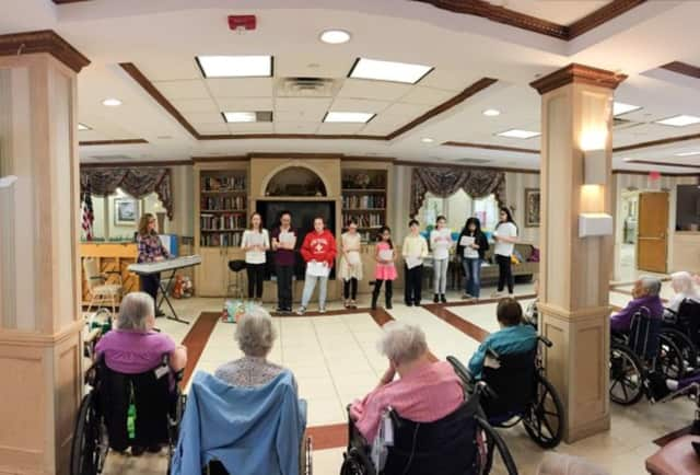 The Felix Fest Middle School Glee Club performing at the Northern Manor Nursing Home.
