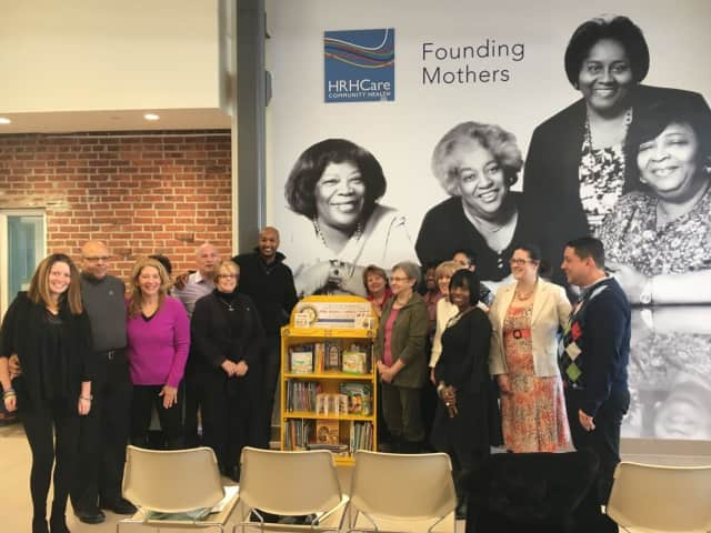 Peekskill Mayor Andre Rainey, HRHCare EVP and Founding Mother, Rev. Jeannette Phillips, and other speakers at the Golden Bookcases event at HRHCare Peekskill.