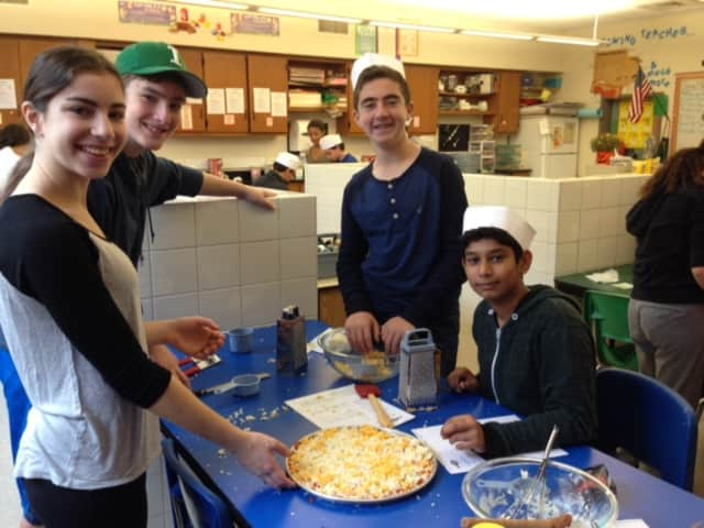 Eighth-graders at Irvington Middle School recently put on their chef hats and applied their math and science skills while making pizza in Teresa Hunt's home and careers class.