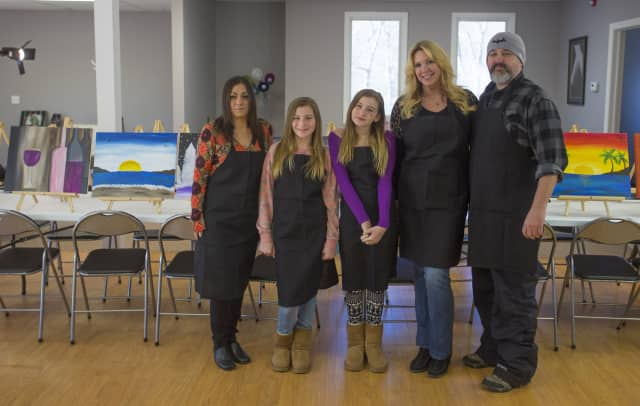 Ringwood's Cork and Canvas staff, from left, Director Dina Pallozzi, Meagan Lynn, Jordan Lynn, Lynne Lynn, and owner Bob Lynn.