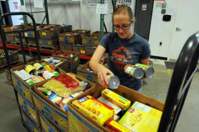 A volunteer packs food boxes at an agency the United Way supports in Greenwich, Conn. The United Way has received a challenge grant from the Tudor Foundation and is aiming to raise at least $50,000 by the end of February.