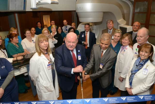 Greenwich Hospital President Norman G. Roth (left) and Ashwatha Narayana, MD, cut the ribbon during a ceremony to unveil the new TrueBeam radiation therapy system, which offers advanced speed and accuracy to treat cancer anywhere in the body.