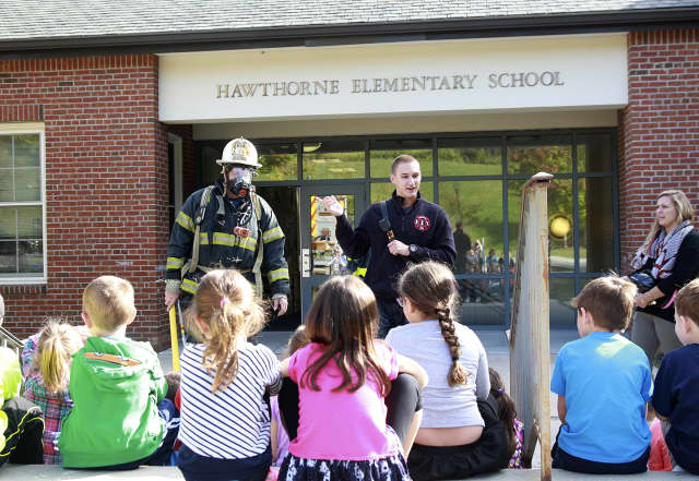 Chief Kos and 2nd Lt. Matt Carroll speak to youngsters at Hawthorne Elementary School