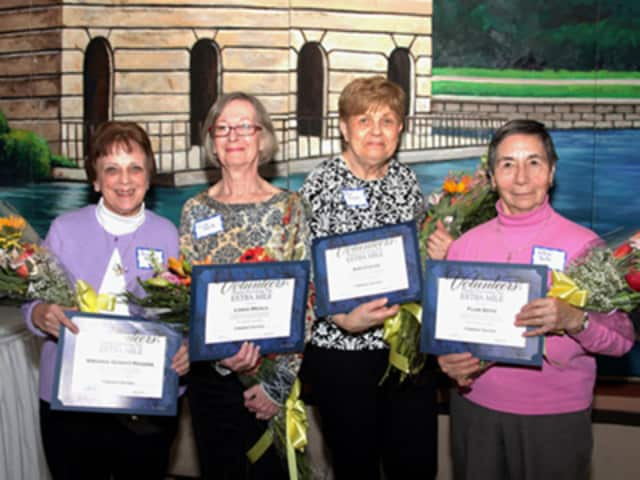 Five volunteers (from left) Virginia Rogers, Linda Meola and Ann Cucak, all from Stratford, Flor Soto of Bridgeport, and (not pictured) Sharon Lisko of Fairfield, received a special award for outstanding service in the hospital's Endoscopy Suite.