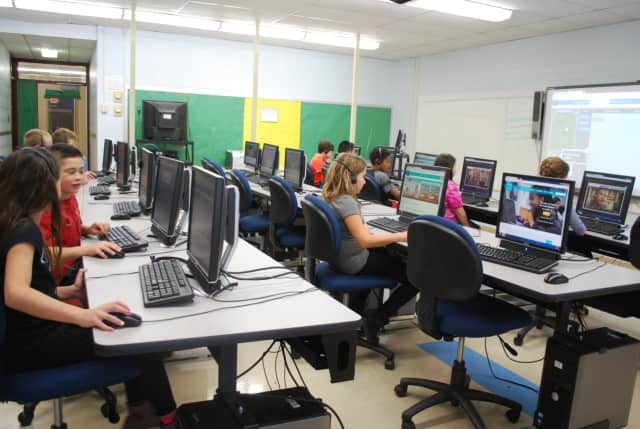 """Students at the Furnace Woods Elementary School in Cortlandt take part in the recent """"Hour of Code,"""" a global initiative designed to introduce youngsters to the concept of computer language."""