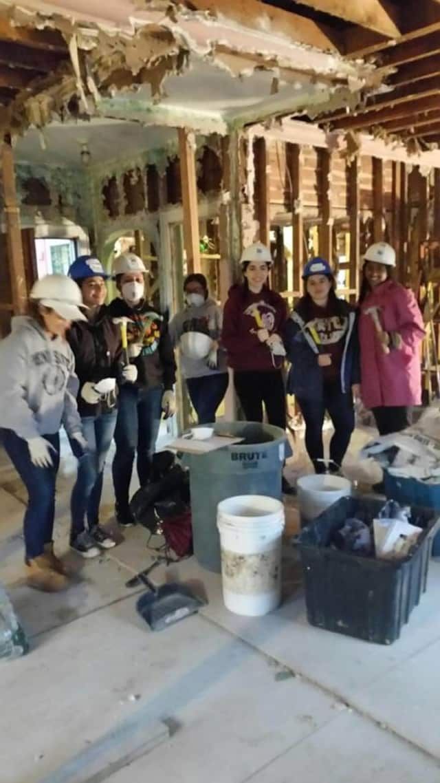 Volunteers for Habitat for Humanity of Westchester work on renovating a home for a family in need. The group has set several events in January, including one where valentines and care packages will be made for U.S. military folks serving overseas.