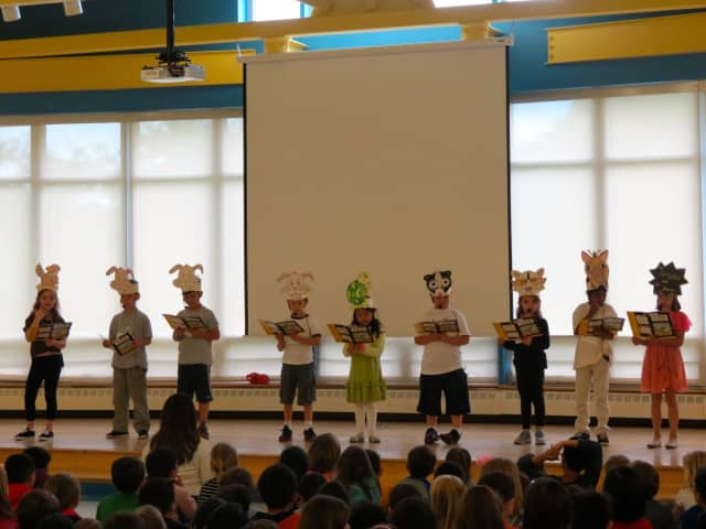 "First-grade students at Todd Elementary School in Briarcliff Manor acted out ""The Tortoise and the Hare"" during a special assembly recognizing the school as a Habits of Mind International School of Excellence."