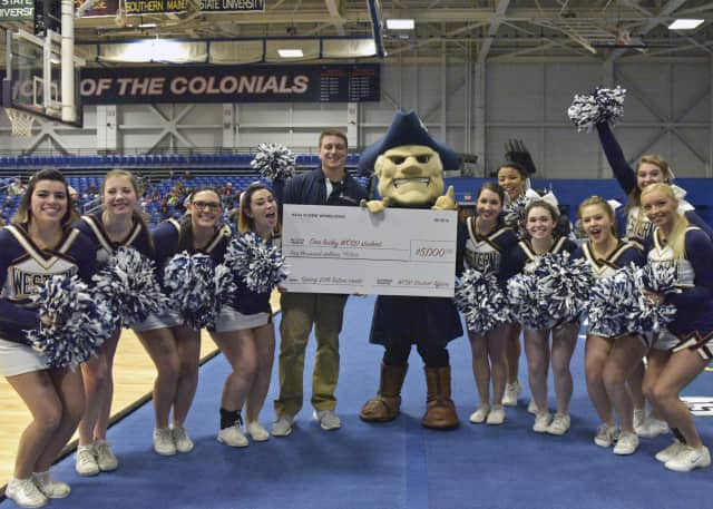 Alfiere is pictured with the university's mascot, Colonial Chuck, and members of the WCSU cheerleading squad.