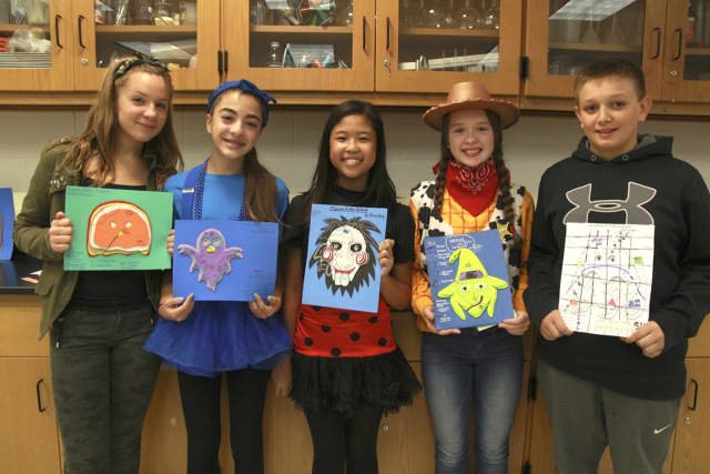 Jessica Prauda, Lea Bonsignore, Laura Eng, Erin Panker, Marco Irizarry, with their scary creations.