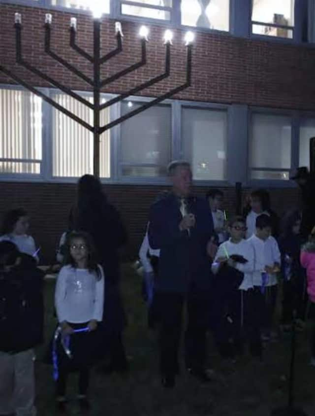 Rockland County Executive Ed Day leads a menorah-lighting ceremony Friday in New City.