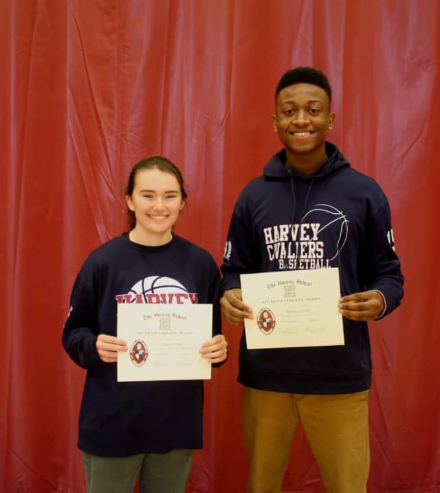 Julia Frisch and Rohan Cassells with their top student-athlete award certificates.