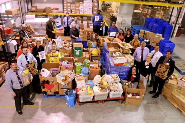 Volunteers from Health Quest are working to ensure area food pantries are well stocked this holiday season.