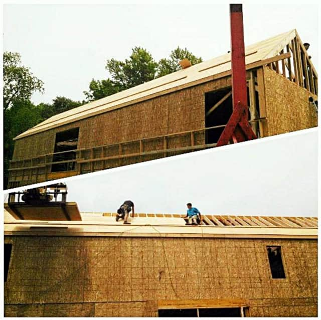 People from Herlihy Construction helped with roofing at Habitat Bergen's current house.