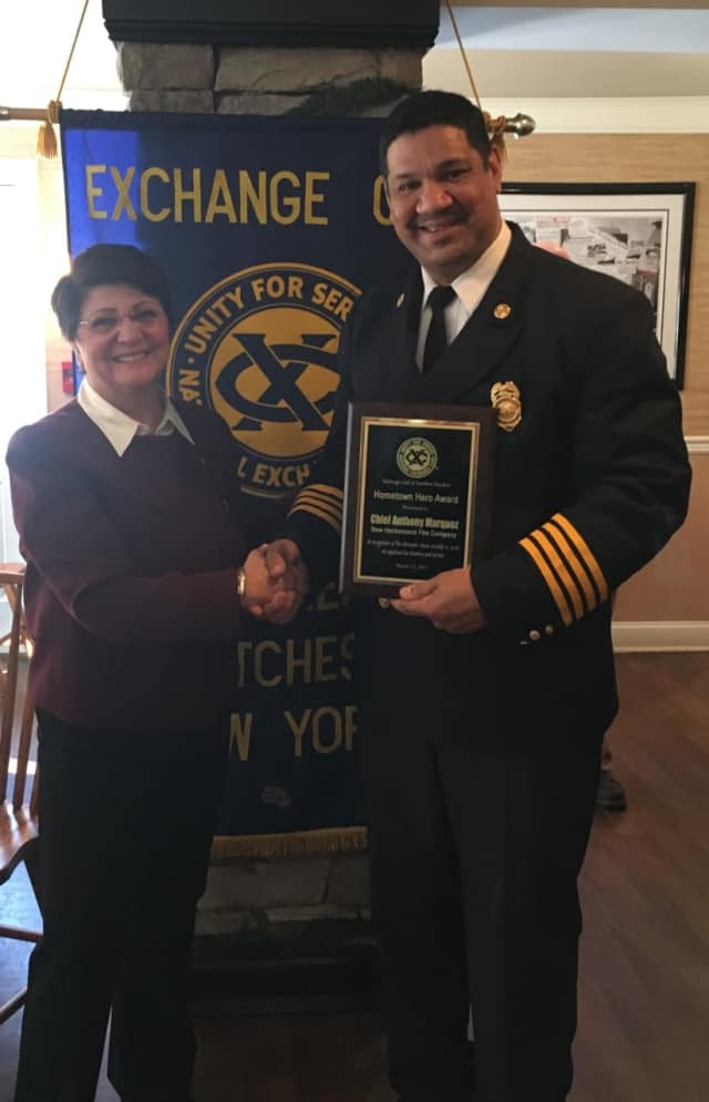 Exchange Club Secretary Pam Tarquinio recognizes Chief Marquez for his heroism.