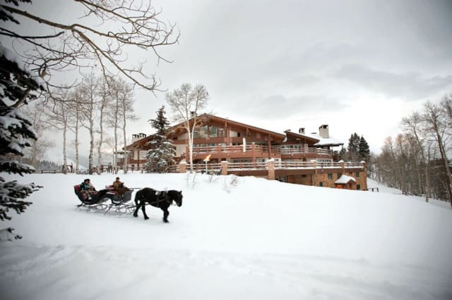 Oh, what fun it is to ride in a one-horse open sleigh past the Stein Eriksen Lodge in Park City, Utah. Photograph courtesy the Stein Eriksen Lodge.