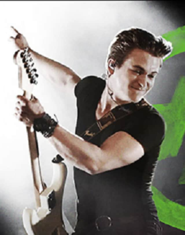 """Hunter Hayes' 10-city, 24-hour tour in 2014, including his stop in Stamford, is part of the new book from Ripley's Believe It or Not!, """"Eye-Popping Oddities!"""""""