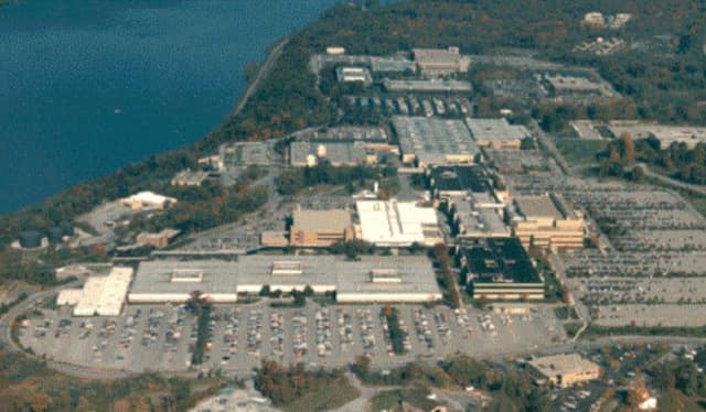 Certain IBM employees will receive a one-month severance package, according to a report in the Poughkeepsie Journal. IBM's Poughkeepsie plant by the Hudson is pictured.