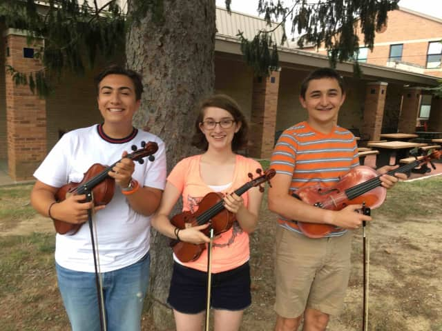 From left, Irvington High School's Gabe Siegel, Clara Montgomery and Brandon Weinstein represent the top students from school music programs across the state.