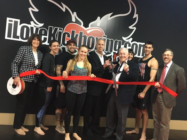 Fairfield Chamber President Beverly Balaz, left, and Community & Economic Development Director Mark Barnhart, right, join First Selectman Mike Tetreau, with scissors, in welcoming iLoveKickboxing to Fairfield.