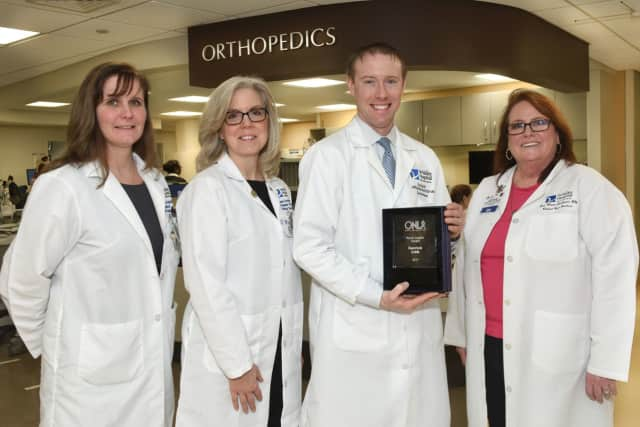 Nancy Barrett-Fajardo, director of Medical/Surgical Services; Bettyann Kempin, assistant VP of Medical/Surgical Services; Nurse Leader Award recipient Derrick Lieb and Ann Marie Leichman, senior VP of Patient Care Services and Chief Nursing Officer.