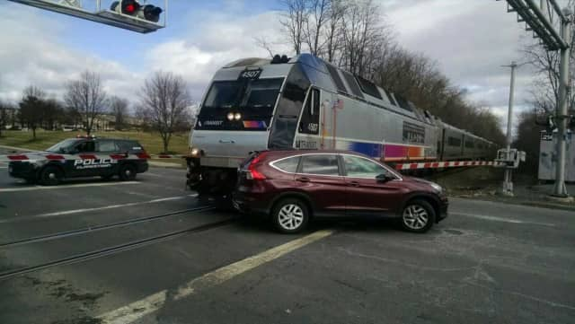 At about 1:30 p.m. Sunday, a New Jersey transit train traveling to Spring Valley struck this car at the New Clarkstown Road crossing in Nanuet.