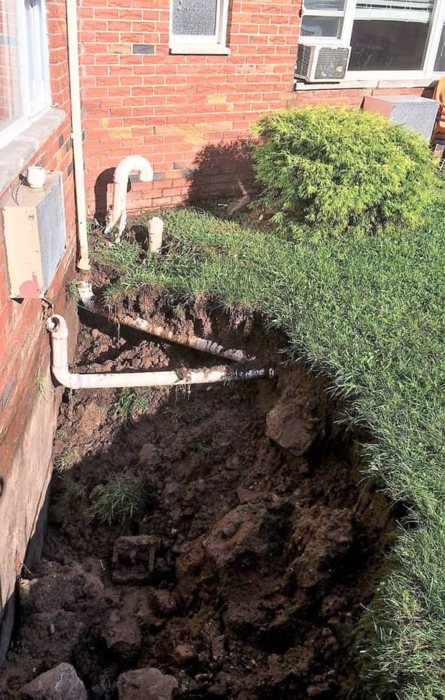 The flood created a huge sink hole, cracked the building's foundation and shifted the gas main, authorities said.