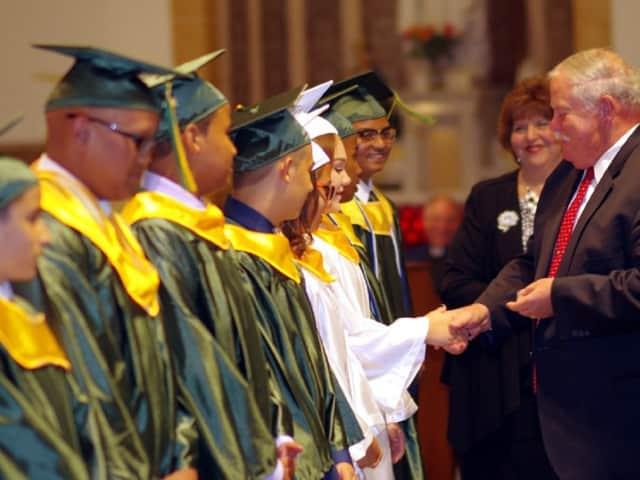 St. Joseph Academy Principal James Newman congratulates the 2016 graduates.