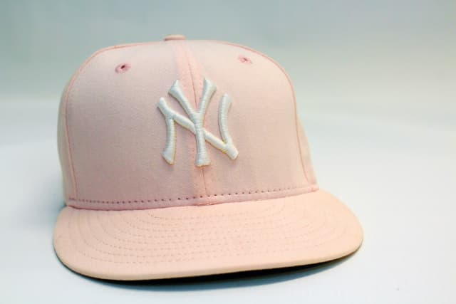 The editor's New York Yankees cap, a breast cancer awareness edition that exemplifies how the hat has transcended its original purpose. (See opening essay on page 16.)