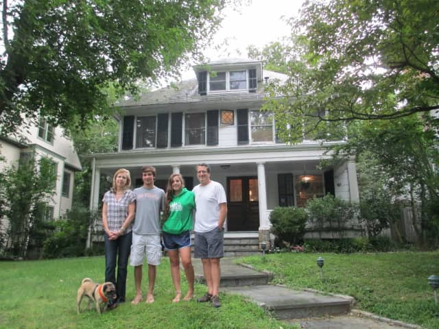 The Chintz family in front of their energy efficient home.