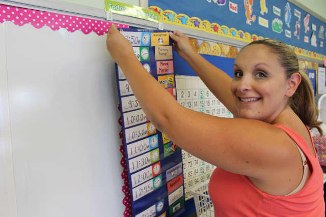 Bergen County Kindergarten teacher Theresa Roman sets up her classroom.