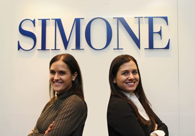 Joanna Simone, left, with sister Patricia Simone at the Simone Development Cos. headquarters in the Bronx.