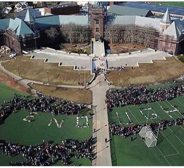 "New Rochelle students formed the word ""Enough"" on National Walkout Day."